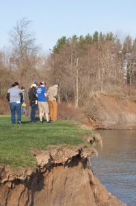 Students examine landforms and sediments on glacial geomorphology field trip.