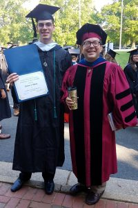 Drew Mesa and Dr. Nabil Al-Tikriti at Commencement, sharing Vance Award